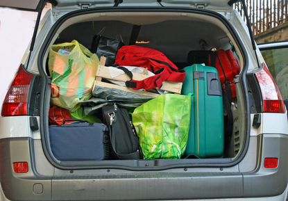 car trunk filled with luggage ready to leave for the winter holidays:safety